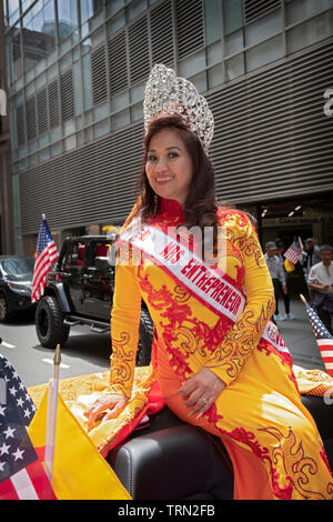 Mrs. Entrepreneur in a beautiful dress & tiara at the Vietnamese American Cultural Parade in Midtown Manhattan, New York City. - Stock Image