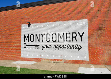 Painted brick wall sign advertising Montgomery Alabama is the key to opportunity. - Stock Image