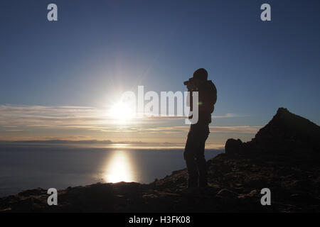 Photographer on a mountain in Iceland - Stock Image