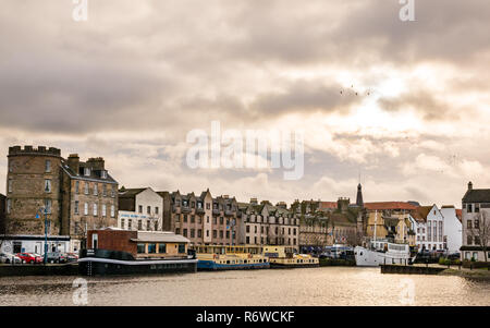Houseboats, river barges and historic buildings in Winter, The Shore, Leith, Edinburgh, Scotland, UK - Stock Image