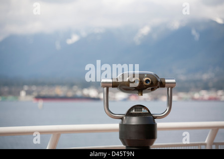 Coin-operated binoculars at Canada Place, pointed across the Burrard Inlet towards the North Shore, Vancouver, British - Stock Image