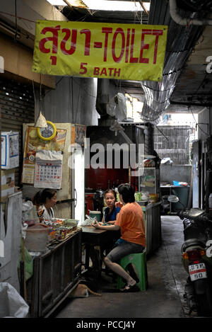 Thailand people meeting in a dimly lit back street alleyway - Stock Image