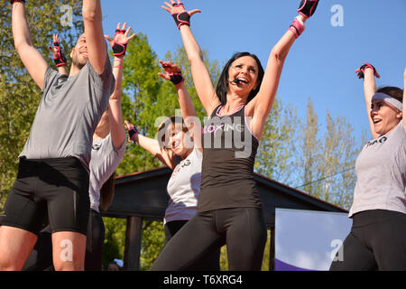 Nis, Serbia - April 20, 2019 Young attractive people practicing Piloxing sport in an outdoor class in summer with instructor - Stock Image