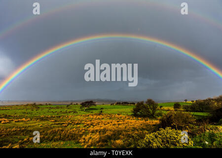 Ardara, County Donegal, Ireland. 22nd March 2019. A rainbow appears on a day of sunshine and showers on the north-west coast. Credit: Richard Wayman/Alamy Live News - Stock Image