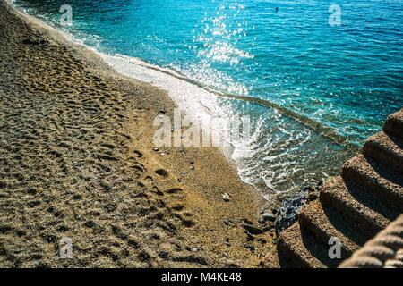 The beautiful aqua blue Ligurian sea and the sandy beach at Monterosso Al Mare, Cinque Terre Italy. - Stock Image