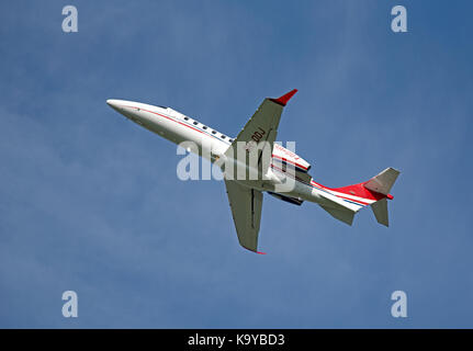Learjet 75 Luxury business aircraft departing from iNVERNESS in the Scottish Highlands. - Stock Image