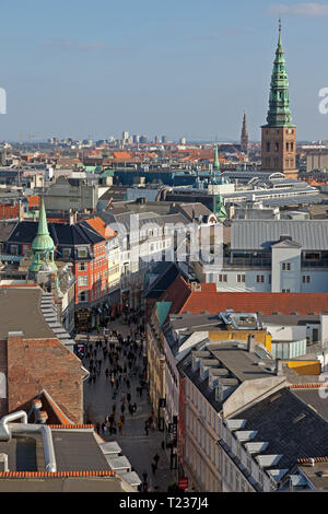 Copenhagen skyline, rooftops, roof terraces, roof gardens and view of the street Købmagergade and Nikolaj Church tower in central Copenhagen, Denmark - Stock Image
