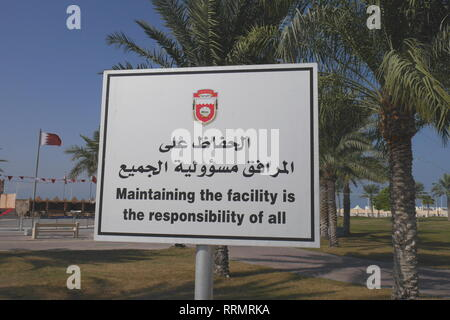 A sign in a park in Arabic and English warning that maintaining the facility is the responsibility of all, Budaiya, Kingdom of Bahrain - Stock Image
