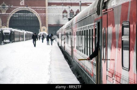 Departure of a passenger train from the train station - Stock Image
