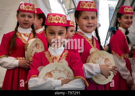 Girls wearing national costume during Hidirelez holiday, a celebration of spring and fertility, in Bakhchysarai, Crimea - Stock Image
