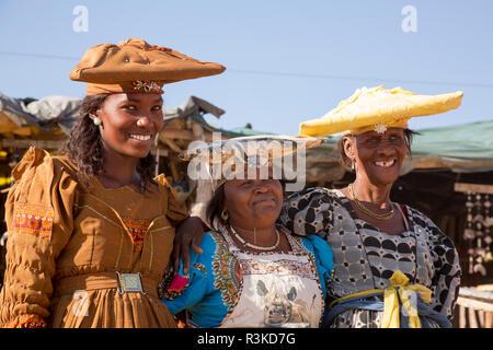 Africa, Namibia. Portrait of three Herero craft women. Credit as: Wendy Kaveney / Jaynes Gallery / DanitaDelimont.com - Stock Image