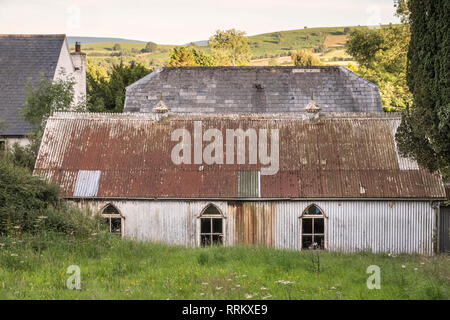 The old 19c corrugated iron village schoolroom and vestry (next to the Adullam Baptist Chapel) in Painscastle, Powys (mid Wales) - Stock Image
