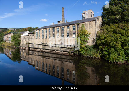 Former swimming baths building alongside the river Calder, Sowerby Bridge, West Yorkshire - Stock Image