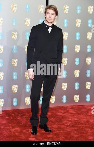London, UK. 10th Feb, 2019. LONDON, UK. February 10, 2019: Joe Alwyn arriving for the BAFTA Film Awards 2019 at the Royal Albert Hall, London. Picture: Steve Vas/Featureflash Credit: Paul Smith/Alamy Live News - Stock Image