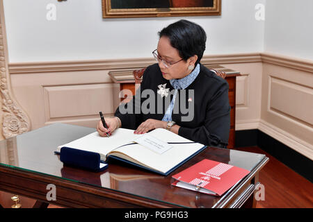 Indonesian Foreign Minister Retno Marsudi signs U.S. Secretary of State Mike Pompeo's guestbook before their meeting at the U.S. Department of State in Washington, D.C. on June 5, 2017. - Stock Image