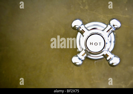 Close-up of a hot water shower knob - Stock Image