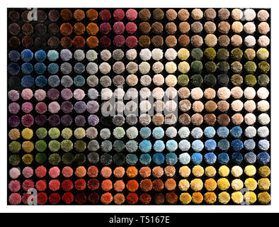 Overhead background texture of multicolored thick velvety pile in moquette textile forming a circular background texture and pattern - Stock Image