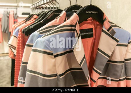 New York, 3/11/2019: Emporio Armani jackets and other items await customers' attention at Bloomingdale's department store in Manhattan. - Stock Image