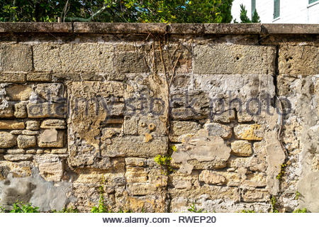 An old coquina or tabby wall on Aviles Street in the historic district of Saint Augustine, Florida USA - Stock Image
