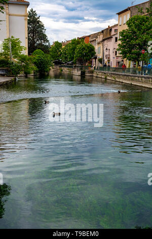 Tourist and vacation destination, view on small Provencal town lIsle-sur-la-Sorgue with green water of Sotgue river, South of France - Stock Image