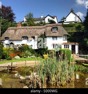 Historic thatched cottage in Bishopstone, Wiltshire, England, UK - Stock Image