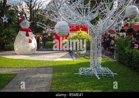 Snowman and frosted tree decorations at outdoor market Montreux - Stock Image