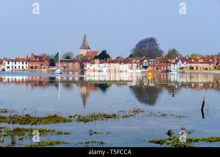 Picturesque old village and church reflected in still waters of Bosham Creek at high tide in Chichester harbour. Bosham West Sussex England UK Britain - Stock Image