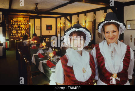 Traditionally dressed waitresses in a Welsh restaurant. Wales. - Stock Image
