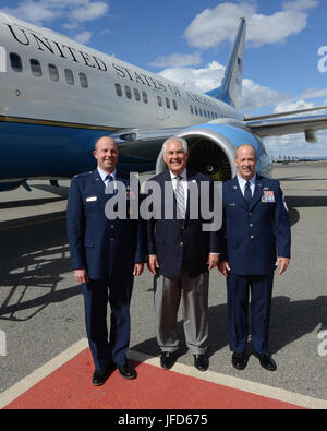 U.S. Secretary of State Rex Tillerson poses for a photo with Col. Todd Robbins, 354th FW vice commander, left, and - Stock Image