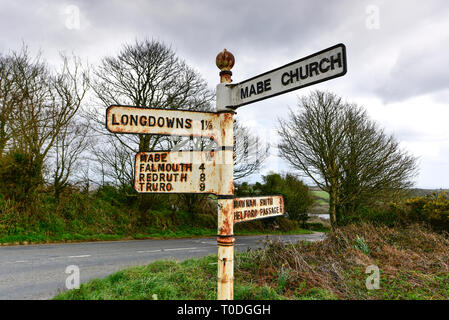 An old metal signpost in Mabe Parish in Cornwall, England, UK. - Stock Image