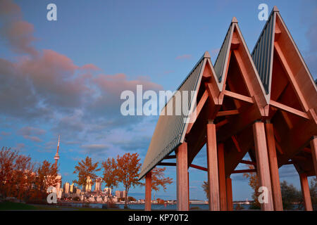 Toronto Trillium Park on waterfront trail under sunset clouds, downtown skyline of landmark buildings in background - Stock Image