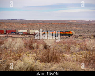 Freight train crossing the Painted Desert. Petrified Forest National Park, Arizona. - Stock Image