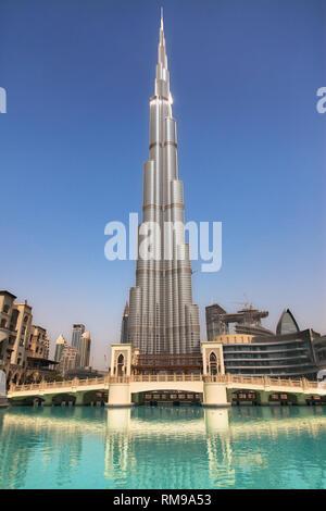 Burj Khalifa and Dubai Fountain Bridge in Dubai, United Arab Emirates. - Stock Image