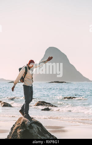 Happy man enjoying ocean beach traveling active lifestyle adventure summer vacations in Norway fun outdoor - Stock Image