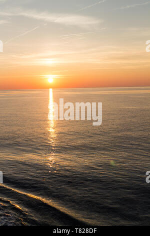 Sunset from a ship cruising in the Mediterranean off the coast of France. - Stock Image