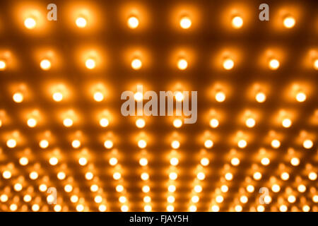 Rows of theater lights out of focus - Stock Image