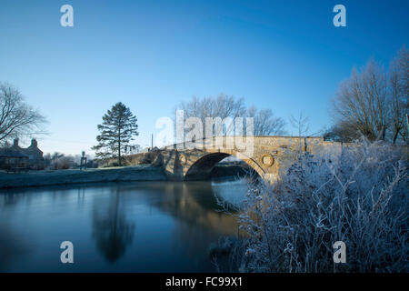 Bridge Over a River in Winter Frost - Stock Image