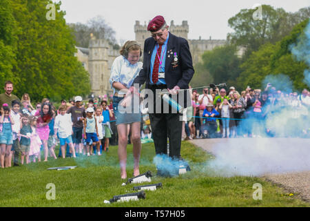 Windsor, UK. 22nd April 2019. John Matthews, borough bombardier, supervises a child in firing a small cannon as part of a traditional 21-gun salute on the Long Walk in front of Windsor Castle for the Queen's 93rd birthday. The Queen's official birthday is celebrated on 11th June. Credit: Mark Kerrison/Alamy Live News - Stock Image