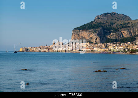 The hill around which is built the coastal town of Cefalu with Baroque style architecture in Northern Sicily, Italy - Stock Image