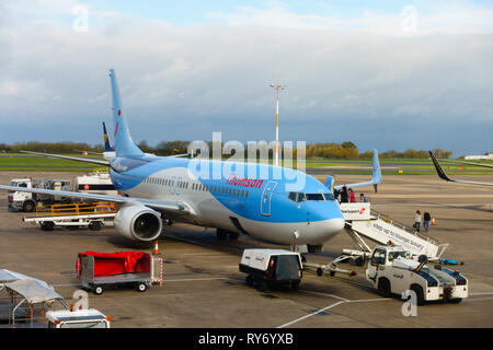 Tui Airways Boeing 737 8K5 (WL) G-FDZR on the apron awaiting turnaround at East Midlands Airport, Castle Donington, Derbyshire, England. - Stock Image