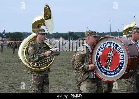Members of the 126th Army Band perform at the Michigan National Guard's annual Memorial Pass and Review, Camp Grayling Joint Maneuver Training Center, Mich., Aug. 24, 2018 (Air National Guard photo by 1st Lt. Andrew Layton/released). - Stock Image