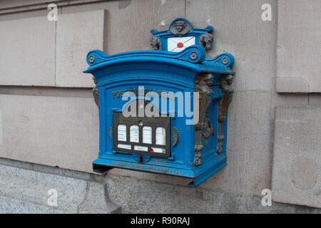 Blue mail box outside the post office in Potsdam, Germany - Stock Image