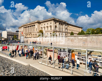 22 September 2018: Berlin, Germany - Tourists sightseeing at a preserved section of the Berlin Wall at Topography of Terror, on  Niederkirchnerstrasse - Stock Image