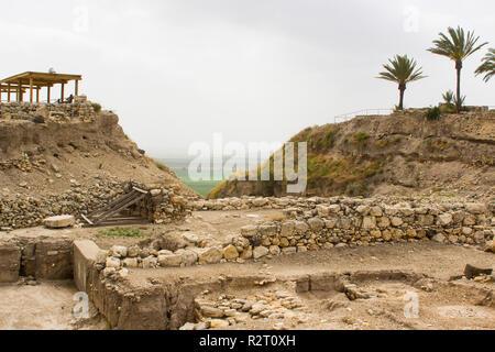 The west side of the excavated ruins of the ancient city of Meggido Northern Israel. This picture shows an excavated trench cut by archaeologists as p - Stock Image