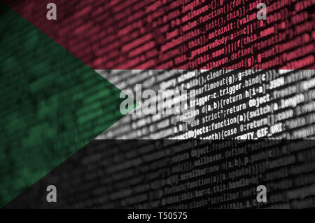 Sudan flag  is depicted on the screen with the program code. The concept of modern technology and site development. - Stock Image