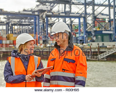 Dock workers with digital tablet at Port of Felixstowe, England - Stock Image