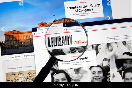 MONTREAL, CANADA - APRIL 24, 2019 : Loc.gov Library of Congress USA Government home page under magnifying glass. The Library of Congress is the nation - Stock Image