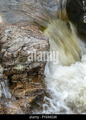Small rocky waterfall in mountain stream of Abhainn nan Leac, Camasunary, Isle of Skye, Scotland, UK - Stock Image