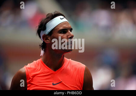 Flushing Meadows, New York - August 31, 2018: US Open Tennis:  Sweat drips fromthe chin of Number 1 seed Rafael Nadal as he walks back to the baseline during his third round match against Karen Khachanov of Russia at the US Open in Flushing Meadows, New York.   Nadal won the match in four sets. Credit: Adam Stoltman/Alamy Live News - Stock Image