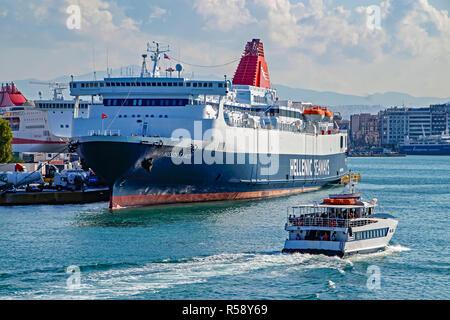 Hellenic Seaways car and passenger ferry Nissos Samos moored in port of Piraeus Athens Greece & Broufas Vessels passenger ferry Georgios Mproufas II - Stock Image